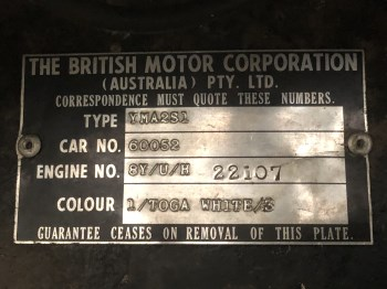Reverse stamped identification plate